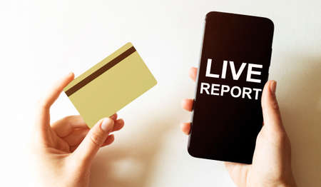 gold card and phone with text disaster recover plan Live Report in the female hands