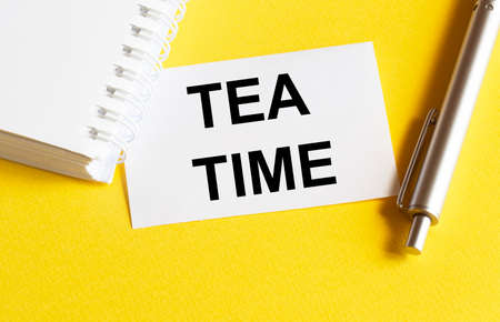 white paper with text Tea Time on a yellow background with stationery
