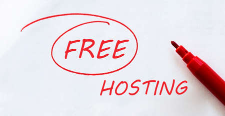 white paper with text Free Hosting on the white with red marker