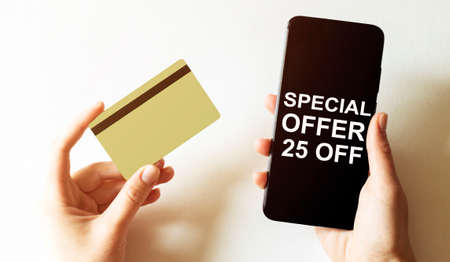 gold card and phone with text disaster recover plan Special Offer 25 Off in the female hands