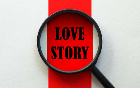 magnifier with text Love Story on the white and red background 스톡 콘텐츠