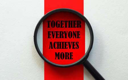 magnifier with text Together Everyone Achieves More on the white and red background