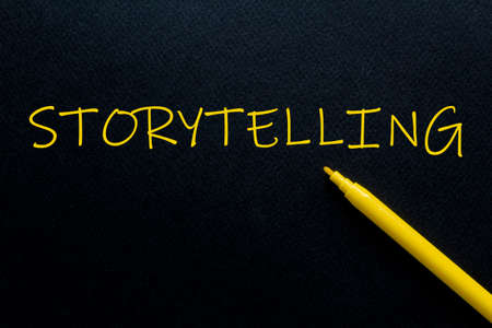Storytelling Yellow Pen with yellow text own rent at the black background