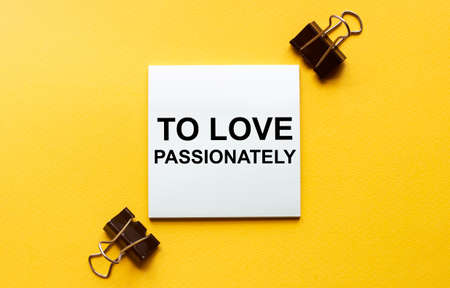 white paper with text To Love Passionately on a yellow background with stationery