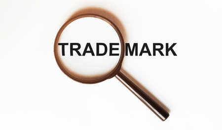 Trademark on a sheet under a magnifying glass