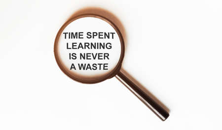 Time Spent Learning Is Never A Waste on a sheet under a magnifying glass