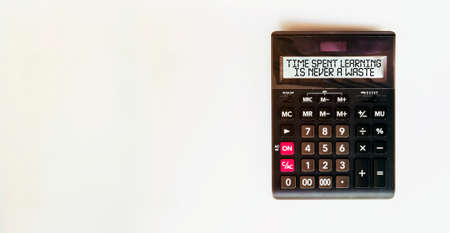 black calculator with text Time Spent Learning Is Never A Waste on the white background