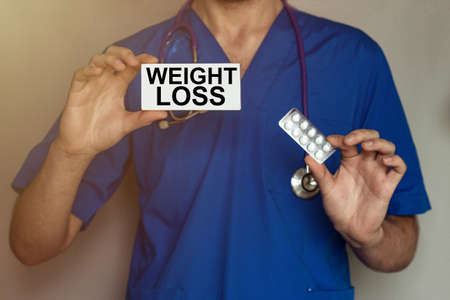 male doctor prescribes prescription for pills Weight Loss Stock Photo