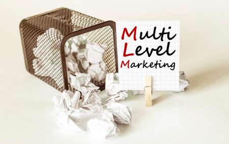white lumps of paper fall out of the case to the paper in the inscription MLM Multi Level Marketing