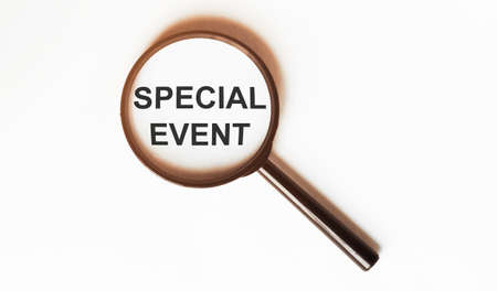 Special Event on a sheet under a magnifying glass