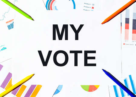 white piece of paper with text My Vote on the background of the graphs, multi-colored felt-tip pens