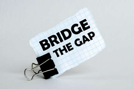 white paper on the white background with text Bridge The Gap