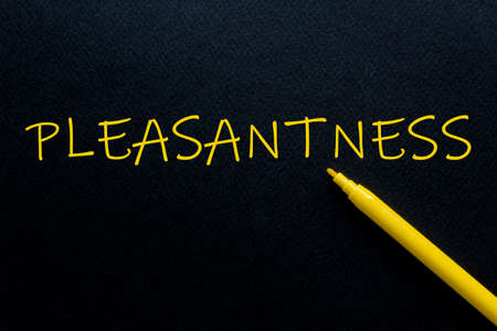 pleasantness Yellow Pen with yellow text own rent at the black background