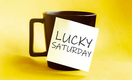 white paper with text lucky saturday on the black cup