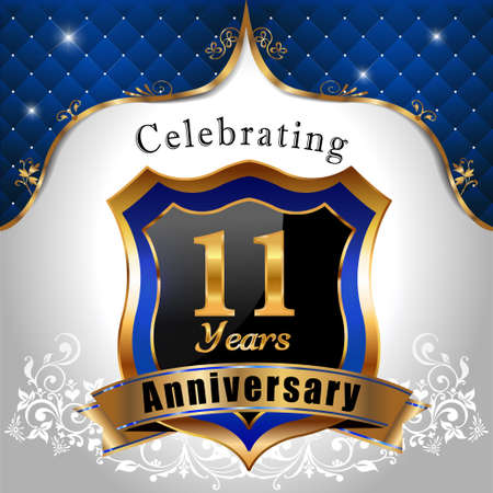 11 years: 11 years anniversary celebration, Golden sheild with blue royal emblem