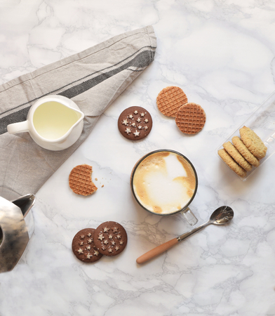Morning coffee flat with cookies on white marble background with cotton runner Stock Photo