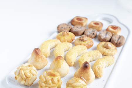 Panellets - typical catalan marzipan dessert for All Saints day called Castaneda,  , white background