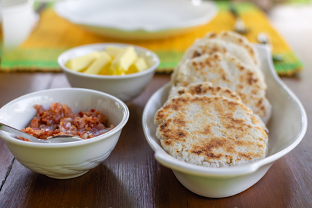 Traditional sri lankan coconut pol roti flat bread with butter and lunu miris dip from red onion and chilli Stock fotó