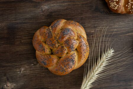 Fresh baked challah bread on rustic wooden background, top view, copy space 写真素材