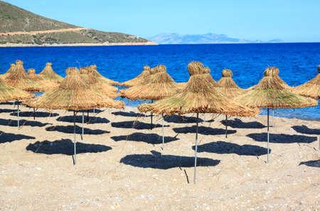wickerwork: wickerwork yellow sun umbrellas on the beach