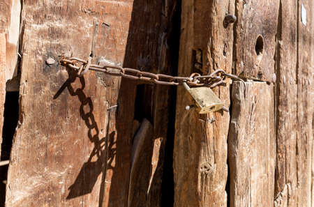 precaution: Padlock is prefered as a security precaution in rural areas Stock Photo