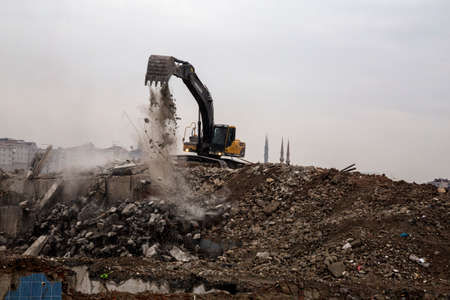 renewal: wrecking crane on debris from urban renewal projects in Istanbul