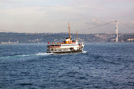 marmara: Boat on Bosphorus under the bridge in a sunny day