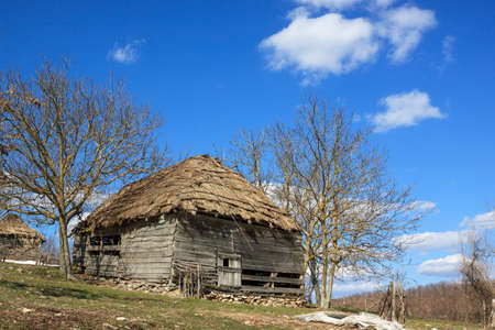 The wooden house in countryside in sunny day photo