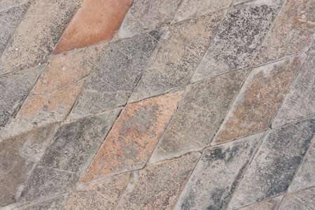 parallelogram: Very old paved church floor background - stone parallelogram tiles Stock Photo