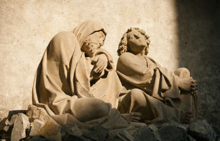 devotions: Quiet meditation: statues of Saint James and Saint John preying in serenity of soul