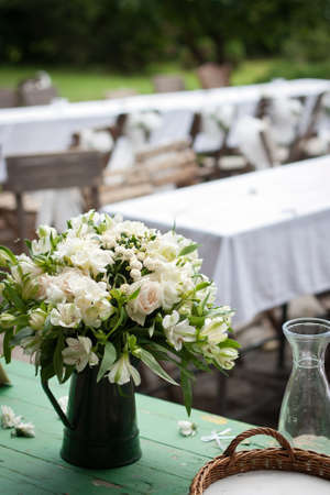 wedding chairs: Countryside wedding reception: close-up of the wedding bouquet Stock Photo