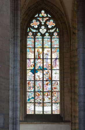church window: Beautiful neogothic painted glass windows in the Saint Barbara Stock Photo