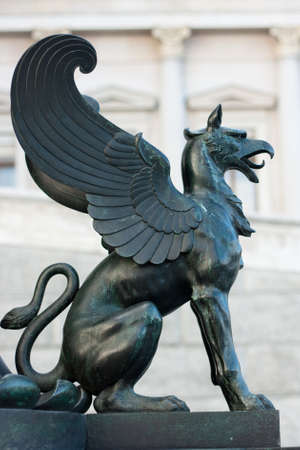 griffin: Statue of a griffin in front of the Viennese parliament (Vienna, Austria) Stock Photo