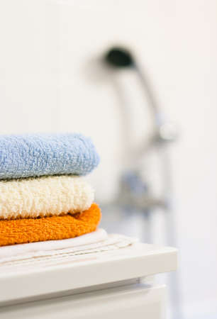 Bathroom interior: closeup of towels folded up on a bathroom cabinet Stok Fotoğraf