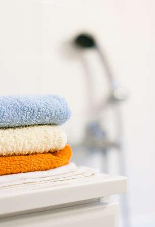 Bathroom interior: closeup of towels folded up on a bathroom cabinet Stock Photo