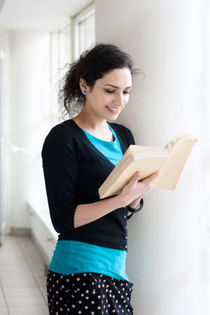 Portrait of a student reading a book photo