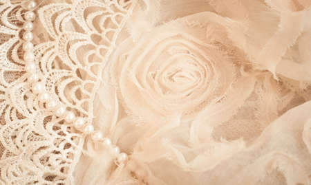 beige: Lace, pearls and chiffon vintage background Stock Photo