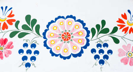 plenitude: Flowers and grapes  closeup of traditional colorful folk painting on the walls of a wine cellar   Petrov, winemaking region in Southern Moravia, Czech Republic  Stock Photo