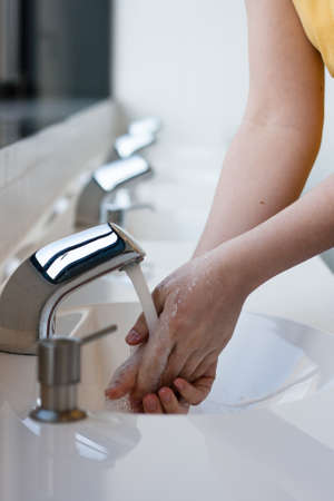 Washing hands in a public restroom (selective focus) Stock Photo - 12715003