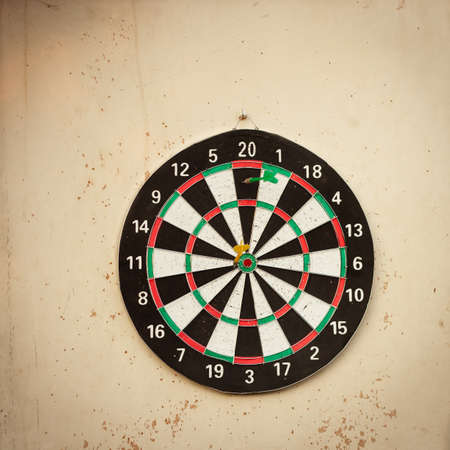 bull     s eye: Dartboard hanging on an old, shabby wall  image with copy space