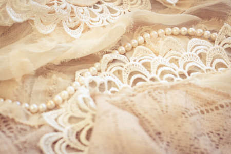 pink pearl: Lace, pearls and chiffon vintage background Stock Photo