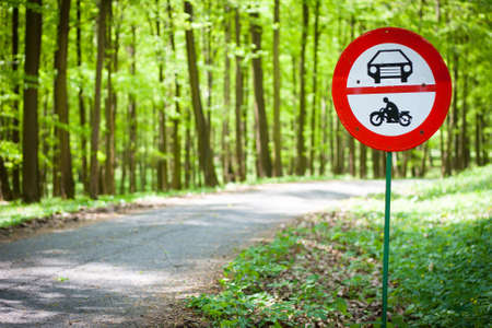 rare animals: No motor vehicles sign at the edge of a  protected forestal landscape area Stock Photo