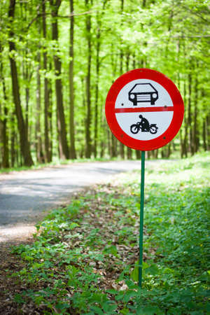 No motor vehicles sign at the edge of a  protected forestal landscape area Stock Photo
