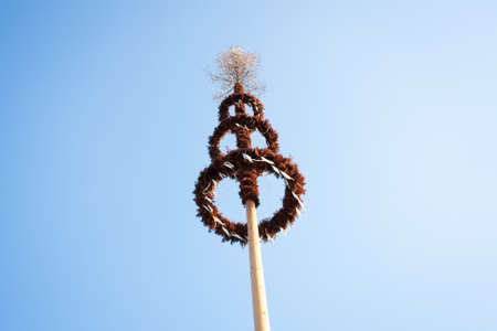 Maypole decorated with garlands against blue sky Stock Photo - 14353783