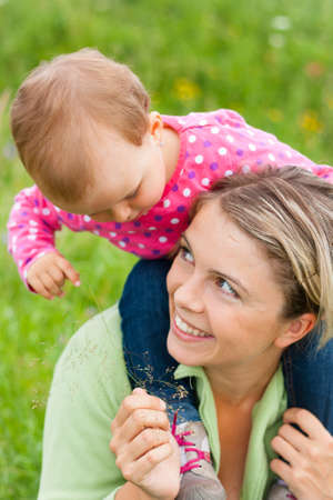 Young mother and her baby girl playing while outdoors on a walk Stock Photo - 14722499