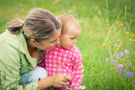 Young mother and her baby girl playing while outdoors on a walk Stock Photo - 14943080