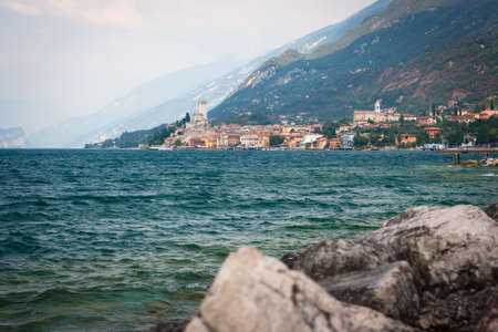 View of the town of Malcesine lying at the foot of Monte Baldo on the northern Lake Garda shores  Veneto, Italy  photo