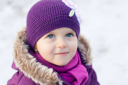 Close-up portrait of a little girl outdoors on a winter day photo
