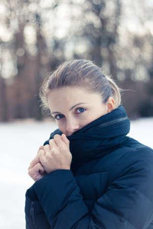 Closeup winter portrait of a beautiful young woman photo