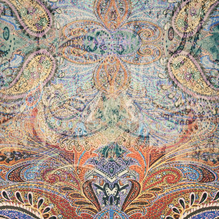 Vintage faded paisley fabric texture background photo